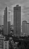 Millennium Residence towers (Thomas Mulchi) Tags: bangkok thailand 2017 panorama verticalpanorama vertorama bw monochrome millenniumresidencetowers highrisebuildings helipads eveninglight krungthepmahanakhon th