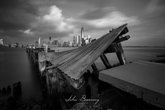 Twisted Pier (johnbacaring) Tags: nyc newyorkcity jerseycity oneworldtrade wtc pier blackandwhite blackandwhitephotography 1776 usa hudsonriver newyorkharbor longexposure leefilters