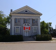 Nokomis SK Bank of Commerce Saskatchewan 20170713_123524 (CanadaGood) Tags: canada saskatchewan sk nokomis building bank flag tree prairie cameraphone 2017 thisdecade canadagood colour color green blue red white