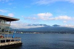 The Drop (Art By Pem Photography: Tao Of The Wandering Eye) Tags: fineartphotography canon canoneosrebelsl1 canonefs24mmf28stm eos sl1 vancouver bc canada travel art sculpture publicart vancouverharbour harbour water mountains clouds sky scenery scenicsnotjustlandscapes blue color colour