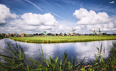 The Zaanse Schans (VandenBerge Photography (and we're back again)) Tags: europeanrouteofindustrialheritage zaanstreek zaanseschans noordholland windmill europe thenetherlands water nature nationalgeographic clouds canon sky skyscape