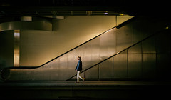 Rendezvous at 2 (fehlfarben_bine) Tags: nikondf sigmaart50mmf14 availablelight underground südkreuz berlin walking gentleman candid urban escalator reflections trainstation
