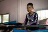 Hmong Boy on a Bunkbed 0085-2 (Ursula in Aus) Tags: hilltribeeducationprojects maehongson santisukschool thep thailand hilltribe children schoolchildren traditional traditionaldress