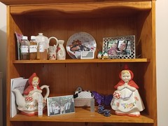 15Aug17 My cluttered hutch with family mementos and pics. The plate, Little Red Riding Hoods and the basket of farm animal coasters are all from my sister. The little green salt and pepper shakers (top shelf) are from my step-mom. #2017pad #photoaday #pic