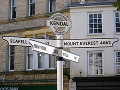 Kendal - mileage pointer - New York, Scafell, Mount Everest, Rinteln. (rossendale2016) Tags: arrangements seating recreational forms stand band bandstand square street main stores restaurants eating retail shops shopping roadway road distance long iconic unusual mount worldwide sailing flying driving information pole pointer indicator mileage direction rinteln scafell york new everest kendal