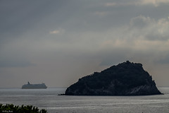 la nave e l'isola (Clay Bass) Tags: 55200 bergeggi spotorno boat clouds fuji natural sea xt1