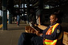 Newspaper (dtanist) Tags: nyc newyork newyorkcity new york city sony a7 konica hexanon 40mm brooklyn coney island mta worker transit subway train platform stillwell avenue station reading newspaper