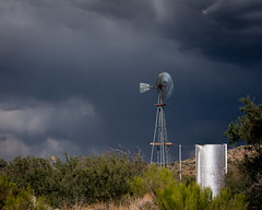 Windmill in Storm (Kyle French) Tags: arizona windmill storm landscape longexposure ranch cattle clouds cloudy stormy thunderstorm