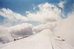 Somewhere Over Frankfurt (Blurmageddon) Tags: 35mm film analogphotography vacation travel nikonf3 nikon35mmeseries kodak portra400 pakonf135 nexlab frankfurt germany frankfurtgermany europe airplane clouds