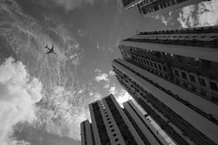 Arrival (Arn_Thor) Tags: noperson city architecture monochrome street outdoors travel building urban black white fujifilm fujixt20 acros filter hongkong hong kong plane approach arrival clouds public housing nofilter