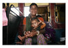 the warm glow of motherhood (handheld-films) Tags: india mother family child portrait portraiture people closeup indian relationships motherhood woman women female families ruralindia togetherness warmth travel subcontinent bus rajasthan interior smile smiling happy happiness