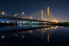 Bridge Over Quiet Waters (Heather Smith Photography) Tags: night tacoma blue yellow suspension urban reflections cooltones washington architecture nikon zeiss21 21ststreetbridge