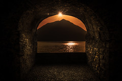 Portal to Sunset over Como Lake with Mountains. (Bart Ros) Tags: ifttt 500px sky sunset water sun summer warm mount mountain darkness nigth waterfront moonlight lightpainting como mistery noche candel candela lake creed ghotic italy