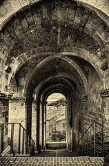 Gubbio_1948-1950_HDR.BW (Brumbaa) Tags: abandoned antique arch architecture blackandwhite buildingexterior builtstructure corridor cultures door history indoors nopeople obsolete old oldfashioned retrostyled tunnel umbria urbanscene wallbuildingfeature