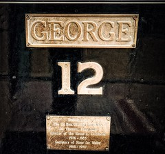 George 12 (Мaistora) Tags: name history story person dedication mp welsh wales train engine mountain railway funicular peak summit snowdon snowdonia detail fragment closeup metal bronze brass yellow black relief texture engraved engraving basrelief text number nameplate britain uk british sony alpha ilce a6000 sel1018oss dxo optics luminar