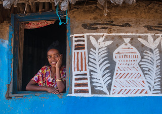 Ethiopia, Kembata, Alaba Kuito, ethiopian woman standing at the window of her traditional painted house