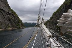 Christian Radich leaving Trollfjorden, Norway (Ingunn Eriksen) Tags: nikond750 nikon trollfjorden hadsel vesterålen nordland norway christianradich tallship fjord fiord mountain sea
