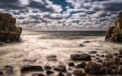 Calm sea and rocky beach (Olof Virdhall) Tags: longexposure ocean waves water beach rocks bluesky sky canon eos5 mkiii olofvirdhall autofocus