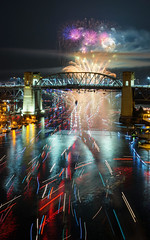 Fireworks Rush Hour (Sworldguy) Tags: fireworks vancouver englishbay bridge burrardstreetbridge boats reflections lights nightscene unitedkingdom display celebrationoflight colourful canada harbour