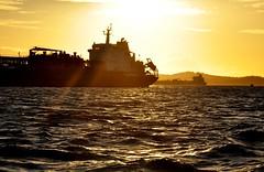 I'll be back after September 20... (Ruby Ferreira ®) Tags: pôrdosol bahiaba ship ripples boat navio barco baía bay braziliannortheast nordestebrasileiro sunset sky clouds