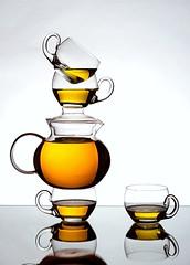 Tea for You & Me (Karen_Chappell) Tags: tea teapot teacup stack balance white orange liquid beverage glass stilllife cup cups reflection