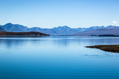 71/100: All is calm, all is bright... (judi may) Tags: 100xthe2017edition 100x2017 image71100 sliderssunday newzealand laketekapo lake water blue blues sky mountains ducks calm serene tranquil tranquility canon7d landscape smooth