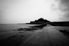 St Michael's Mount (lsullivanart) Tags: england britain unitedkingdom uk europe cinematicphotography film art filmic cinematographer cinematography widescreen cinemascope cinematic cinema scenic scenery beautiful natural views sand pebbles rock seascape water wave sea ocean seafront seaside coast shore beach landscape summer storm outdoor overcast cloudy atmospheric dramatic moody weather clouds sky fujifilm1024 fuji1024 fujinonxf1024 fujinon1024 xt2 fujixt2 fujinon fujix fujifilm fuji snapshot snap shoot shooter shot photography stmichaelsmount mountsbay medieval stmichaels monochrome bw monotone monochromatic blackandwhite bnw nocolour white black wb