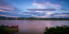 The house that faces Laos (ajecaldwell11) Tags: lights longexposure mekong laos sunset river purple chiangkhong buildings thailand xe2 fujifilm clouds