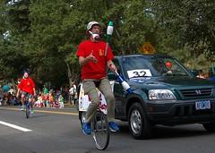 Unicycle Juggling (swong95765) Tags: unicycle man juggle juggling skittles parade balance skill