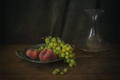 Still Life with Grapes and Peaches (suzanne~) Tags: stilllife tabletop grape peach fruit food winedecanter bottle chiaroscuro painterly art lensbabysoftfocusoptic textured