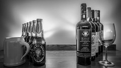 Choices Choices ... (Fret Spider) Tags: beer wine mug pint glass mono monochrome vignette bottle vino quebec unibroue lafindumonde brunello montalcino taurasi radici linsieme riserva terredelprincipe bw blacknwhite candle wick hop malt barley sangiovese pinotnero aglianico casavechhia alcolhol canoneos5dsr canonef24mmf14liiusm ultrawideangle