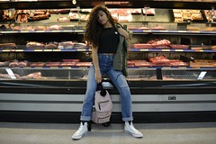 'just chillin' (miranda.valenti) Tags: just chillin posing sitting meat section walmart pose hair bag clothes clothing colors store leading lines color
