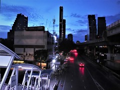 blue hour metropolis (SM Tham) Tags: asia southeastasia thailand bangkok sathon sathorn chongnonsibtsstation coveredwalkway stairs steps streetscene road street vehicles cars lights cityscape skyline buildings bluehour sky clouds