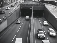 under or over? (OhDark30) Tags: coronet clipper folder folding camera 120 50s monochrome film bw blackandwhite bwfp fomapan 100 rodinal 1100 semistand development underpass queensway tunnel birmingham a38 traffic cars queue cones headlights