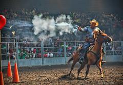 Rootin-Shootin Cowboy (jackalope22) Tags: isf barrel gun shoot balloons hors cowboy fair iowa jacobso