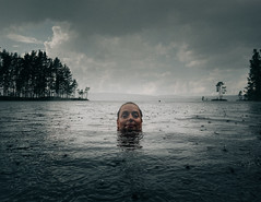 (Svein Skjåk Nordrum) Tags: rain raindrops swim lake summer norway woman landscape scenery sky clouds nature water grain