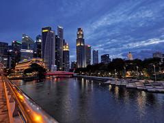Riverside walk (elenaleong) Tags: singaporeriver landmark skyscrapers cityscape sundown riversidewalk buildings bridge bluehour elenaleong