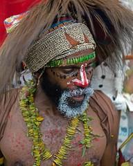 man looking down (kthustler) Tags: goroka singsing papuanewguinea tribes huliwigmen mudmen