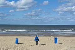Three times blue (Jan van der Wolf) Tags: map162111v blue blauw woman wife trashcan coat sky clouds landscape landschap seascape seaside shore kust beach strand garbagecan afvalbakken vrouw symmetric symmetry symmetrie noordwijk wolken sea zee zand sand jas