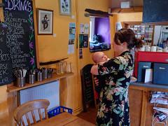 #14 primal but no scream (watcher330) Tags: newcastleemlyn woman baby cafe blackboard drinks