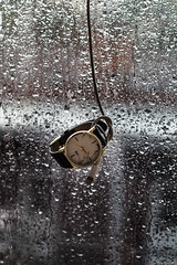 """""""How tragic it is to find that an entire lifetime is wasted in pursuit of distractions while purpose is neglected."""" (Nerdgirl1993) Tags: time watch tempest rain window black white detail focus clock montre temps quote wasted technology ipod iphone cable"""