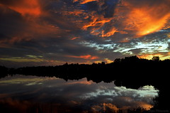 The last moments of the day (Captions by Nica... (Fieger Photography)) Tags: sunset sunsets sunlight clouds cloud colorful colors dusk reflections reflection water landscape lake silhouettes silhouette nature weather outdoor quebec canada