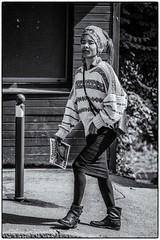 Chasseuse d'images (bertranddorel) Tags: noiretblanc blackwhite rue street streetphoto femme woman urbain urban urbano ville ciudad people seul personne france