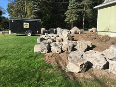 More rocks showed up.  Starting to look like castle construction. (deroller) Tags: landscaping hardscaping landscape rocks boulders dolomite limestone plantings lighting volt cumberland bay patio front yard remake