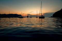 Balearic anchorage.... (Dafydd Penguin) Tags: sunset water sea boats sailboat sail cruising cruiser anchorage anchor sun queen victoria evevning light bay cala harbour benirras ibiza balearics island spain nikon df nikkor 20mm af f28d