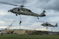 Sailors fast-rope from MH-60S Sea Hawk helicopters at Naval Base Guam.