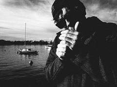 smoke (matthias hämmerly) Tags: candid street streetphotography shadow contrast grain ricoh gr black white bw monochrom monochrome city town urban blackandwhite strasse people monochromphotography einfarbig personen silhouette zuerich swiss switzerland dark smoking smoker man lighter boat lake zuerichsee