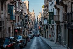 Valletta streets (teodorpk) Tags: malta valletta travel street urban tourist traveller europe trip visit visitmalta exploremalta southerneurope buildings road cars sea sky