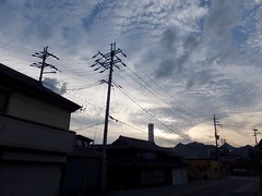 a town at dusk (Hero Yama) Tags: cloud town street house shadow 兵庫県 dusk telegraphpole city japan 家 空 青 blue 電柱 電信柱 夕方 evening houses 雲 影 シルエット 夕暮れ