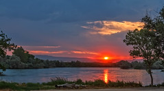 Sunset Over The Snake River (http://fineartamerica.com/profiles/robert-bales.ht) Tags: mountain river landscape snake sky outdoor dawn park sunset summer national scenery stream flyfishing idaho sunrise valley usa recreation evening snakeriver outdoors unitedstates twilight fish reflection red sunreflection northwestphotography idahophotography beautiful sensational spectacular riverphotography panoramic awesome magnificent peaceful surreal canonshooter haybales scenic clouds robertbales sun hazy glow riversedgepark